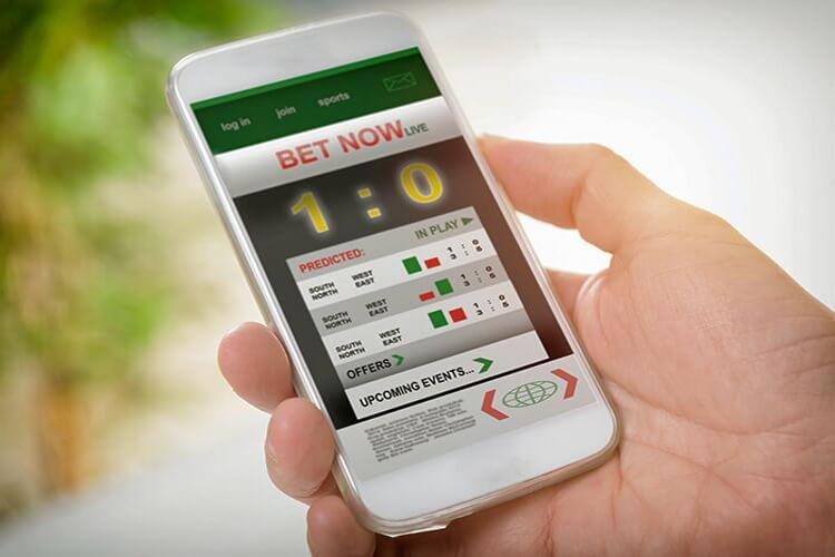 Apuesta en vivo smartphone con apuesta en vivo | celular en la mano con apuestas 01